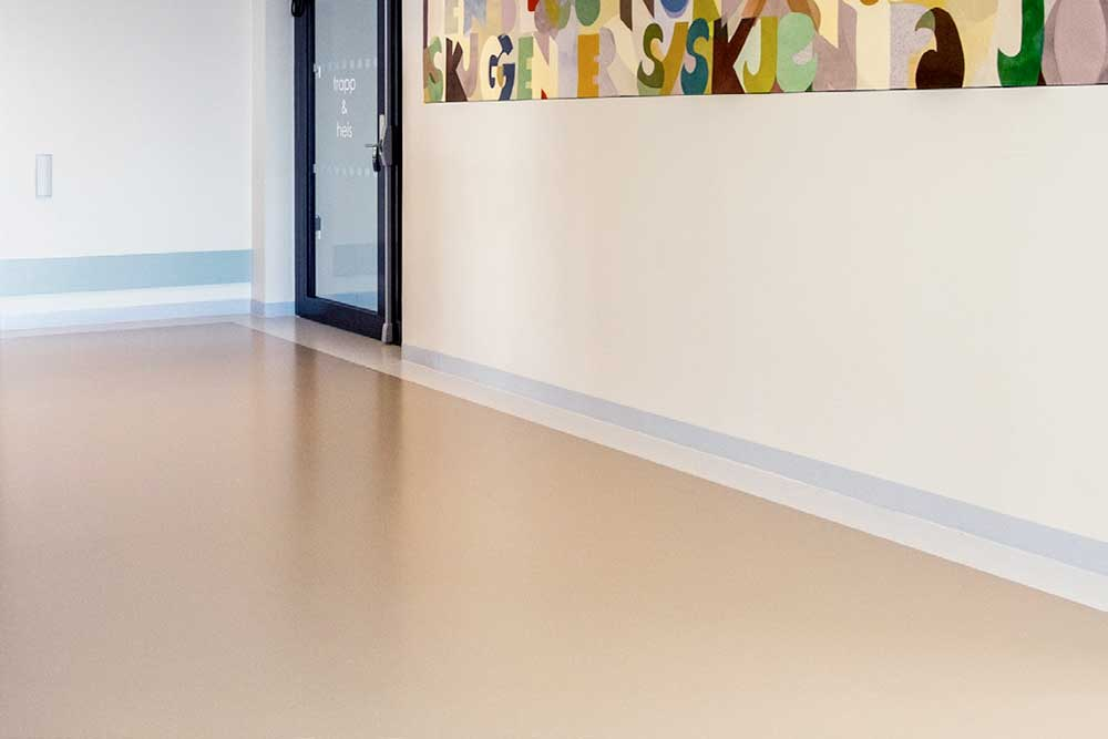 The quiet tones of the Artigo Kayar flooring provide the relaxed atmosphere and ensure good lighting conditions. Available from Chroma Gloabl Flooring Solutions